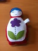 Symbolen: een poppetje gemaakt door een cliënte na het verlies van haar dochter op 20weken zwangerschap